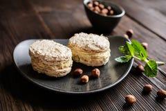 Hazelnut Meringues filled with hazelnut cream Royalty Free Stock Photography