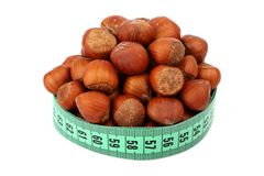 Hazelnut and meter Royalty Free Stock Photo