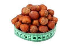 Hazelnut and meter Royalty Free Stock Photo