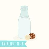 Hazelnut milk in a glass bottle. Vector EPS 10 hand drawn illustration Royalty Free Stock Photos