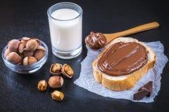 Hazelnut nougat cream on slice of bread Royalty Free Stock Images