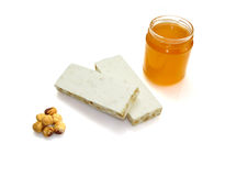 Hazelnut, nougat and jar of honey Stock Photography