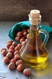 Hazelnut oil in the glass bottle and nuts Royalty Free Stock Photo