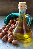 Hazelnut oil in the glass bottle and nuts Royalty Free Stock Images