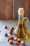 Hazelnut oil in the glass bottle and nuts Stock Photography