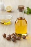 Hazelnut oil and hazelnuts Stock Photo
