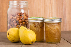 Hazelnut and pear conserve in jars. Hazelnut and pear conserve in mason jars with pears and hazelnuts Royalty Free Stock Image