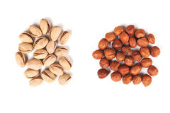 Hazelnut and pistachios isolated Royalty Free Stock Photos
