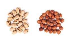 Hazelnut and pistachios isolated Royalty Free Stock Photos