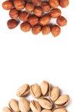 Hazelnut and pistachios isolated. Some hazelnut and pistachios isolated on white Royalty Free Stock Image