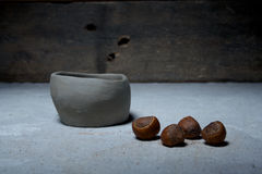 Hazelnut and pottery Stock Photography