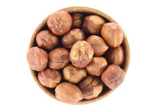 Hazelnut in a round wooden form. On a white background Stock Photos