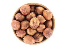 Hazelnut in a round wooden form Stock Photos