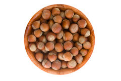 Hazelnut in round wooden plate. Royalty Free Stock Photography