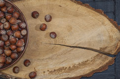 Hazelnut in shell on a brown wooden surface Royalty Free Stock Photo