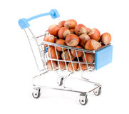 Hazelnut in a shopping cart isolated on white background Royalty Free Stock Photography