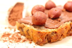 Hazelnut and slices of bread with chocolate cream Royalty Free Stock Image