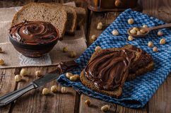 Hazelnut spread delicious. Homemade hazelnut spread on whole grain bread heathy Royalty Free Stock Image
