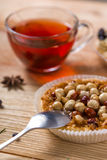 Hazelnut tart with caramel. On wooden table Royalty Free Stock Images