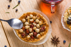Hazelnut tart with caramel. On wooden table Royalty Free Stock Image