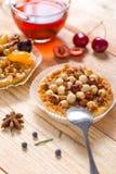 Hazelnut tart with caramel. On wooden table Royalty Free Stock Photos