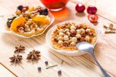 Hazelnut tart with caramel. On wooden table Stock Photo