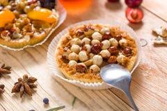 Hazelnut tart with caramel. On wooden table Royalty Free Stock Photo
