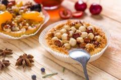 Hazelnut tart with caramel. On wooden table Stock Photography