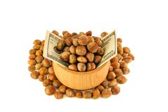 Hazelnut Turkish hazel to a wooden bowl. The concept of the grow. Th of the transformation of hazelnut nuts into money dollars. Isolate on white background stock photos