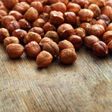 Hazelnut on wooden background Royalty Free Stock Photography