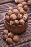 Hazelnut on a wooden table Stock Photography
