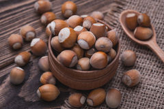Hazelnut on a wooden table Royalty Free Stock Images