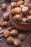 Hazelnut on a wooden table Royalty Free Stock Photo