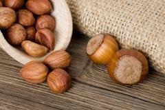 Hazelnuts. Ripe hazelnuts on wooden board Royalty Free Stock Image