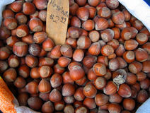 Hazelnuts. Bag of hazelnuts for sale royalty free stock photos