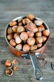 Hazelnuts. In a copper ladle Stock Photo