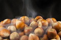 Hazelnuts. Cooking hazelnuts,  on black background Royalty Free Stock Image