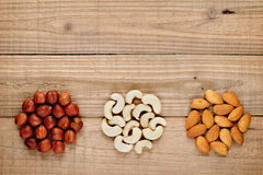 Hazelnuts, almonds and cashew nuts Stock Photos