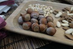 Hazelnuts and almonds Stock Photo