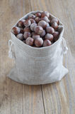 Hazelnuts in bag. Hazelnuts in linen bags on a wooden table Stock Photos