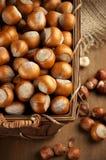 Hazelnuts in basket Stock Photography