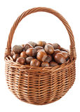 Hazelnuts in basket isolated Stock Photos