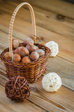 Hazelnuts in the basket. Hazelnuts in a small basket Royalty Free Stock Images