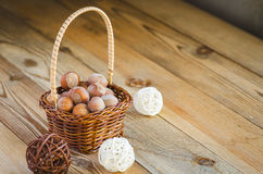Hazelnuts in the basket. Hazelnuts in a small basket Royalty Free Stock Photography