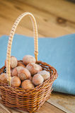 Hazelnuts in the basket. Hazelnuts in a small basket Royalty Free Stock Photos