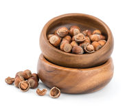 Hazelnuts in a beech wood bowl and loose Royalty Free Stock Photography
