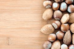 Hazelnuts on the board Stock Images