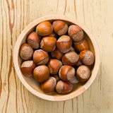 Hazelnuts in bowl Stock Images