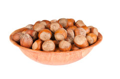 Hazelnuts in a bowl. Against a white background Stock Photo