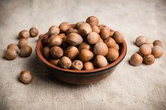 Hazelnuts in a bowl of earthenware stock images
